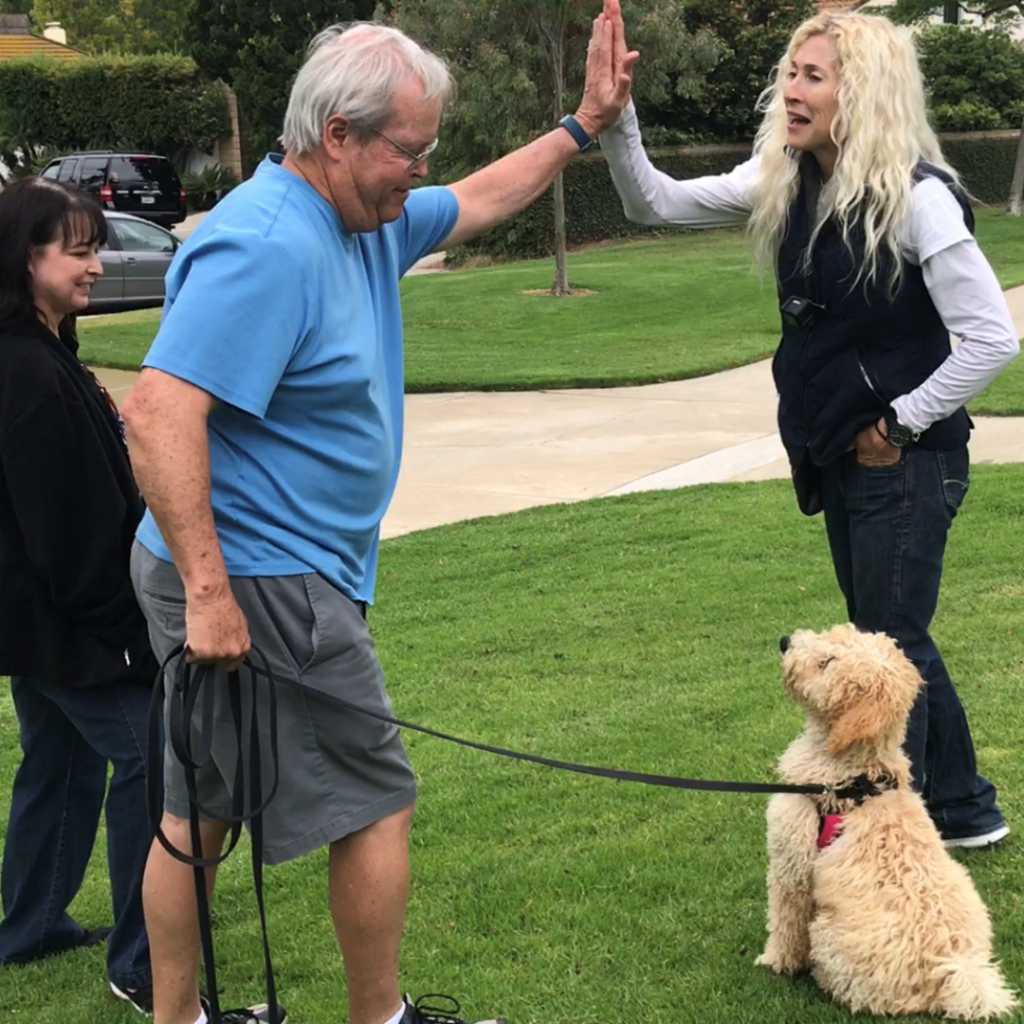 Jennifer with 2 clients and their dog